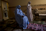 """Sheikha, 42, a single mother of five girls, prays with her daughter at home after work in Riyadh, Saudi Arabia, March 2015.  Sheikha works at Al-Nahda Philanthropic Society for Women in Riyadh; she has two daughters of her own, and three daughters from her sister. She works as a cleaner at Al-Nahda, and the house was given to her by the foundation. She explains, """"You cannot stop progress. Once the progress starts, it is very difficult to stop it. King Abdullah was the biggest helper for women and this progress. It was like we were all asleep, and he was like, """"wake up, wake up, lets all do this together."""" Allah created us as equals. We have different roles, it does not mean we are not equal. …I am not a baby-making machine, or a vacuum cleaner, or someone who says yes, sir, or no, sir. Once all my kids graduate from school, I want to go back and get my high school certificate. I was 16 when I got married, and 21 when I had my first baby. I don't have plans to marry again. I have everything I need: I have my work, I have my girls, my house. What do I need a man for? So he can come and eat and sleep on my dime? Everyone says you need a male guardian to go to the market, to sit in a taxi. Why do they say this? My guardian is my God. Who is better than that?"""""""