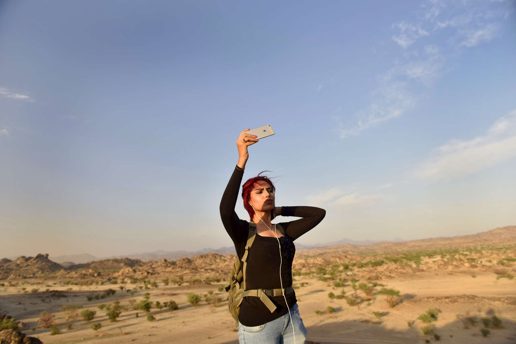 A young Saudi woman does a selfie while on an forbidden co-ed hike in the desert outside of Jeddah, Saudi Arabia, May 2015.