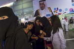 Saudis and foreigners attend the Riyadh Book fair under a banner of Saudi Arabian King Salman at the King Abdullah Conference Center in Riyadh, Saudi Arabia, March 2015.