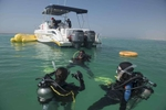 Saudi Scuba diver instructor, Shaima Malikah, 24, does a short dive with Noor Mansour, 23, an advanced diver, and two beginner divers, Maha, 19, and Assma, 18, Saud,  in Jeddah, Saudi Arabia, December 5, 2014.