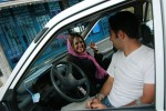 Young Iranians hang out in their car outside of an icecream shop in North Tehran, Iran, July 8, 2005.
