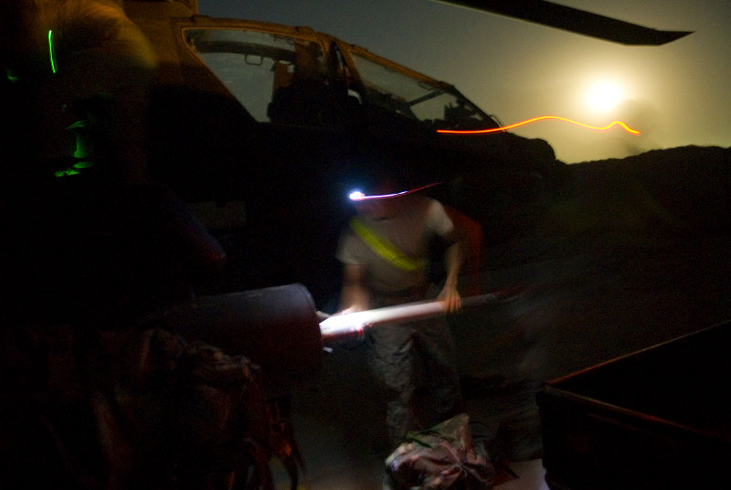 US MILITARY BASE IN SOUTHERN AFGHANISTAN: TASK FORCE CORSAIRA 15-y armaments technician loads infrared illuminations rockets onto an apache a-64 delta model before a possible hostile night mission.  (credit: Lynsey Addario)