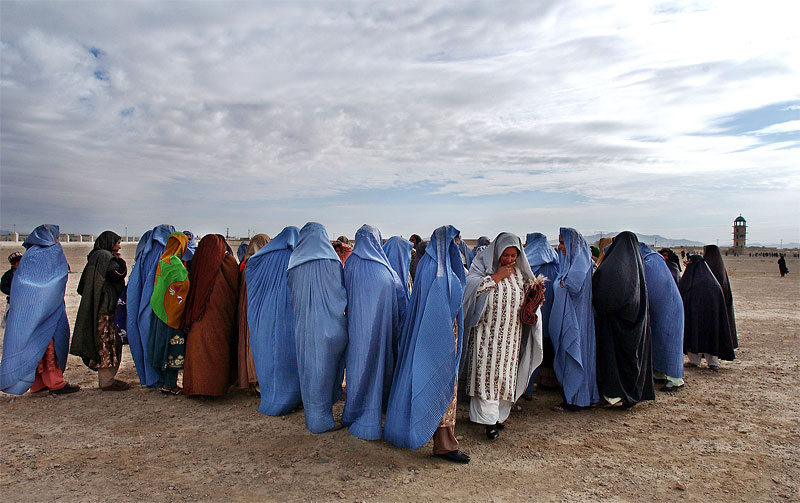 afghan misc and  afghan war muslim women attend an eid prayer service in the female section beside the