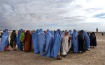 Afghan War: Muslim women attend an Eid prayer service in the female section beside the main mosque in Kandahar, Afghanistan December 16, 2001.  Since the fall of the  Taliban, and the subsequent loosening up of restrictions for women in Afghanistan, many women came out in public this year for the first time to pray at the mosque, rather than in their homes.