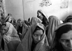 Afghan War: Female teachers, some veiled, some unveiled, attend a co-ed meeting for the re-opening of schools at the Educational Headquarters building in Kandahar, Afghanistan December 19, 2001.  Since the fall of the formerly ruling Taliban, and the subsequent lifting of restrictions on education and cultuaral forums, Afghans across the country are preparing new schools and re-opening ones that have been closed for some time.