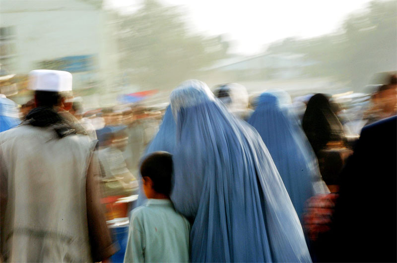 Afghanistan post-Taliban: Afghan women walk through Kabul's main bazaar, in Afghanistan, August 16, 2005.  Afghanistan has seen much progress in some areas of infrastructure and human rights, and dismal lack of progress in other areas, as it gears up for its first Parlimentary elections since the fall of the Taliban in 2001.