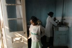 Kenia Moravelo, 13, stands by the door of  the shelter where she has been staying since released from her most recent stay in the hospital, November 1, 2006.  Kenia was sodomized by her uncle three years prior, and went through several surgeries to try to repair her rectum and colon, which were destroyed in the rape.  Kenia almost completely stopped eating after the rape in order to avoid the pain she endured going to the bathroom, and is only now gaining a little weigh back after years of being extremely thin.