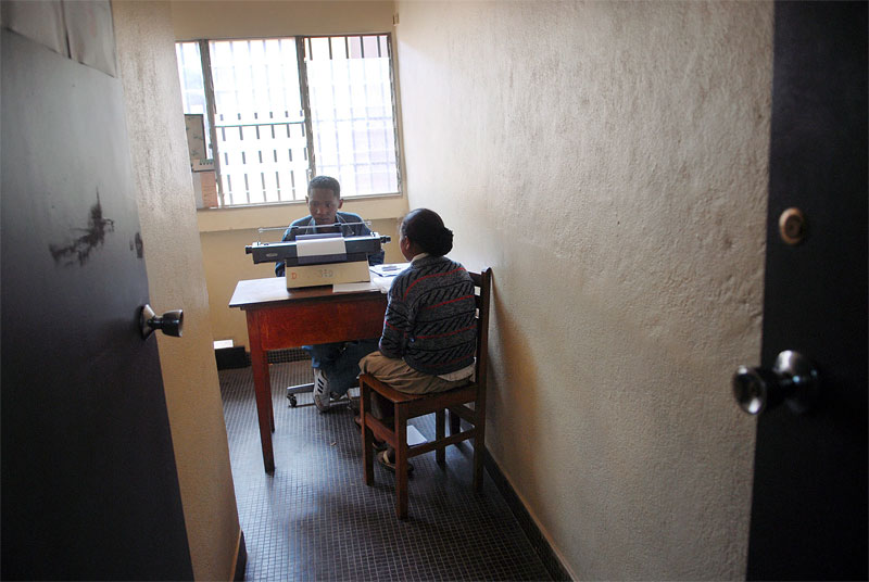 Many, 15, files a report during an investigation into her rape by a neighbor three weeks prior at the main police station in Antananivarro, Madagascar, November 9, 2006.  Many, threatened by her assaulter, was too scared to tell her mother about her rape until three weeks after the crime, and her family was barely able to pay the $15. cost of paying for a medical examination necessary for filing a case against the perpetrator.