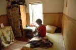 Hanitra, 12, sits in her bedroom in the Akany Avoco shelter for girls, in Antananivarro, Madagascar, November 7, 2006.  Hanitra, originally from Ancilla bay, was a victim of sexual assault by her boss while she was working as a maid in Antananivarro at 11 years old, and was sent to Avoko by the court for safety, where she has been living for over a year.