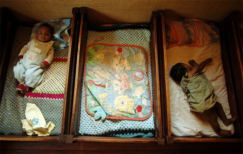 Babies lie in cribs in the Akany Avoco shelter for girls, in Antananivarro, Madagascar, November 8, 2006.  Avoko provides shelter for juvenile delinquants, orphans, and kids who can not live at home with their parents for security reasons.