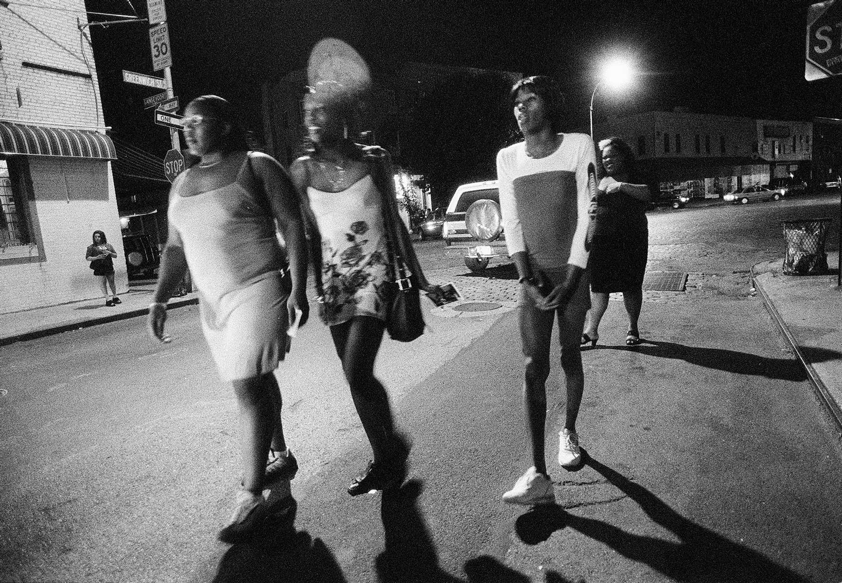 Sex workers walk through the West Village's meat-packing district Saturday night.  September 1999.