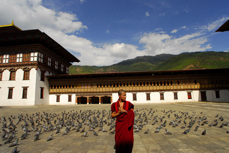 Namgay Wangchuk, 19, from Punakha, stands in the courtyard of the Thimphu Dzong, where he is studying in Thimphu, Bhutan, April 21, 2007.  A Dzong can be found in most district capitals throughout Bhutan, and is the seat of secular and religious authority in each district--half administrative headquarters, half monastery.  Within the Monasteries that line the countryside throughout Bhutan, young monks are taught Bhuddist studies, manners, and basic home skills among their studies and prayers. traditionally in Bhutan, families used to send one child per family to the monastery, though now it is up to the individual family to decide whether they would like to send a child.