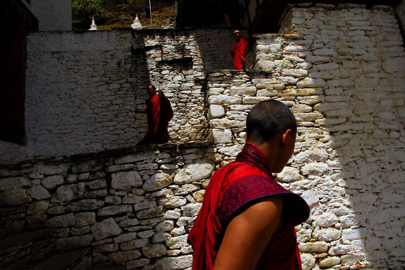 Bhutanese monks take a break from morning studies in the 8th century Kurjey Lhakang Monastery in Jakar, in the province of Bhumthang, Bhutan, April 28, 2007.  While Bhutan is Bhuddist, Bhumthang is considered the spiritual heart of the country.