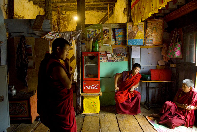 Monks hang out in their bedroom inside the monastery in the Dzong in Wangdue Phodang, in western Bhutan, May 9, 2007.  Though Bhutan has traditionally been isolated from the outside world, a Coca-Cola fridge managed to make its way into monks' lives.  A Dzong can be found in most district capitals throughout Bhutan, and is the seat of secular and religious authority in each district--half administrative headquarters, half monastery.  Within the Monasteries that line the countryside throughout Bhutan, young monks are taught Bhuddist studies, manners, and basic home skills among their studies and prayers. traditionally in Bhutan, families used to send one child per family to the monastery, though now it is up to the individual family to decide whether they would like to send a child.