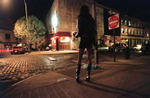 Carey waits for tricks in the West Village's meat-packing district in New York. April 4, 1999.