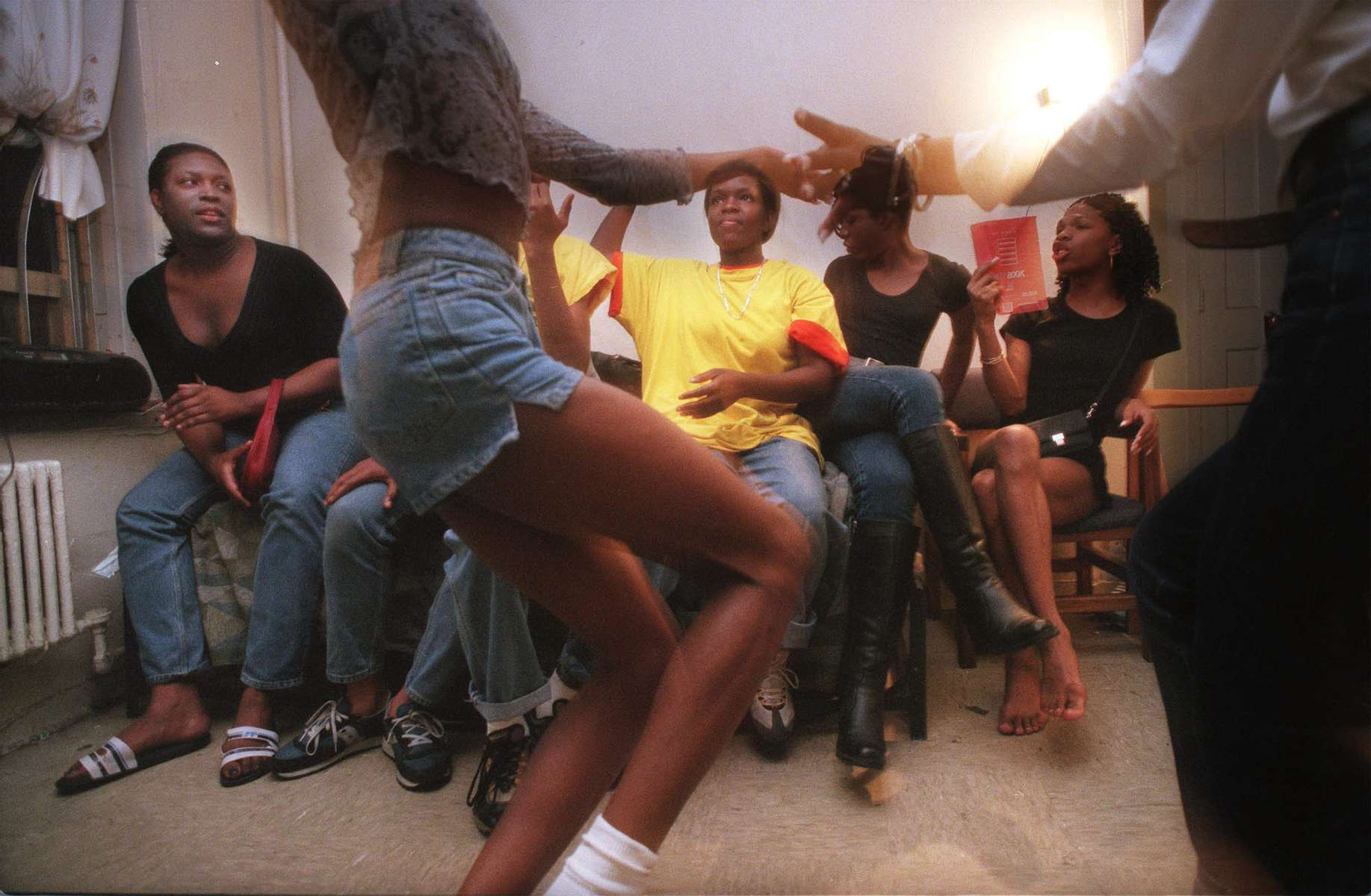 Trans women gather and perform for each other one Thursday afternoon at Kima's apartment in the projects in Harlem.  They dance for each other while practicing for transgender balls which take place throughout the city during the year.