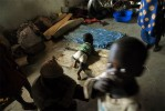Thousands of people displaced from dozens of surrounding villages due to recent fighting gather inside a church for shelter adjacent to a base of Pakistani peacekeeping forces in the village of Aveba, about 80 km south of Bunia, in the Democratic Republic of Congo, June 11, 2006.