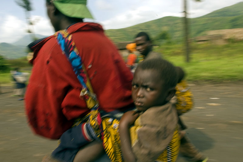 Hundreds of Congolese people flee the village of Kingi towards Sake as intense fighting takes place between the Congolese Army, the FDRC, and soldiers loyal to the rebel Tutsi leader, Nkunda, in the east of the Democratic Republic of Congo, December 11, 2007.  In the last few weeks, the FRDC has been making a large-scale military push to take back villages they lost to Nkunda late last year, and the civilian population has been caught in the middle.  Thousands of civilians have been displaced from their homes across the region of North Kivu, and are suffering  grave health and malnutrition crisis. In the last 12 months, about 410,000 Congolese civilians have been displaced by new fighting, and coupled with the previous 400,000 from past years, there are now about 800,000 internally displaced people in the DRC.  (Credit: Lynsey Addario for The New York Times)