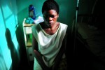 Chibalonza, 26, sits in the hospital in Walungu, South Kivu, in Eastern Congo, April 14, 2008. Chibalonza was kidnapped by six men in uniforms and brought to the forest for nine months, where she was raped repeatedly.  'I am alone here--all my family is dead...they killed two of my children, one in front of me--struck a hammer to his head, and the other I couldn't see.  They killed my husband in the Ninja forest. My sister saw the death of my husband....They were interhamwe.  They spoke KenyaRwanda and we walked for four days to reach the forest where they kept me in a hole underground surrounded by rocks....'  An average of 400 women per month were estimated to be sexually assualted in the autumn of 2007 in eastern Congo, while in the first months of 2008, the figure dropped to an average of 100 women per month. This said, many women never make it to treatment centers, and are not accounted for in these statistics.