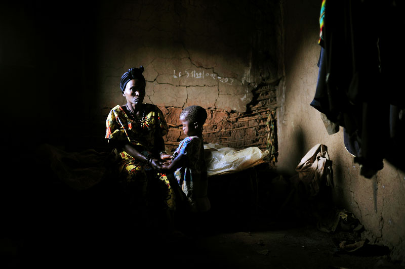 Lwange, 51, sits with her three year old child, Florida, in a village in North Kivu, in Eastern Congo, April 12, 2008. Florida was raped by a man in his mid-twenties about a week prior while her mother was working in the home.  'The child was behind the house and screamed a lot. when i went outside to see what was happening, there was a man who was not wearing pants, and he ran away with his pants in his hands. The child was bleeding alot, and her vagina was in bad shape. Since that day, my daughter does not speak. she used to speak a lot, but she does not speak anymore....' An average of 400 women per month were estimated to be sexually assualted in the autumn of 2007 in eastern Congo, while in the first months of 2008, the figure dropped to an average of 100 women per month. This said, many women never make it to treatment centers, and are not accounted for in these statistics.