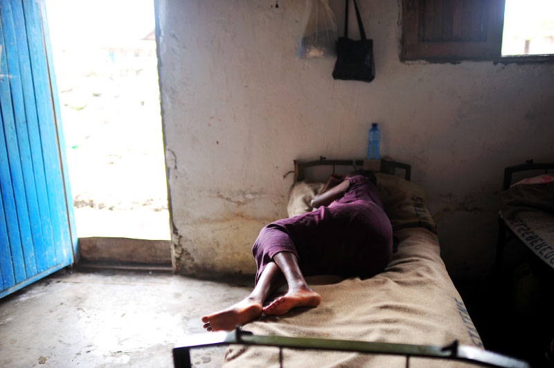 Nelly, 14, from Massissi, lies pregnant in the Keyshero shelter and medical centers in Goma, North Kivu, in Eastern Congo, April 9, 2008. An average of 400 women per month were estimated to be sexually assualted in the autumn of 2007 in eastern Congo, while in the first months of 2008, the figure dropped to an average of 100 women per month. This said, many women never make it to treatment centers, and are not accounted for in these statistics.