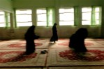 Women pray at a madrassa for international students in Qom, one of the holiest cities in Iran, December 2005.