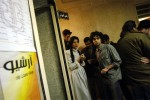 Young Iranians hang out outside of an underground rock concert in Tehran, Iran, January 26, 2006.