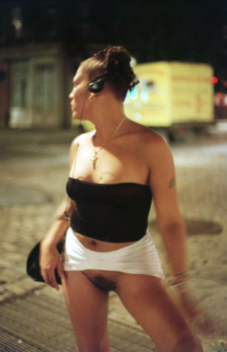 Josie walks the street in Manhattan's West Village early Sunday morning, June, 1999. Josie is one of the few trans women who has actually been castrated, and intends to undergo full surgery as soon as she can afford it.  She often walks the street exposed, and has spent some time at Rikers Island for prostitution.