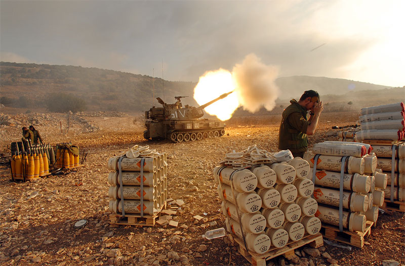 An Israeli artillery unit continues to fire tanks along the frontline as fierce fighting between Israeli and Hizbollah soldiers continues, in Northern Israel, July 29, 2006, in Israel.  Civilians on both sides of the war continue to die as Israeli troops continued their air and ground assault across Lebanon and Hizbollah fighters continue to send rockets into Israel.