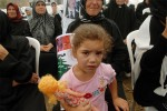 Abir Khalid, 5, cries during a funeral for the 23 villagers killed by an Israeli airstrike while trying to flee Marwaheen during the war, August 24, 2006.  Hundreds of people gathered in Marwaheen in a funeral delayed because villagers have been too scared to return home as Israeli troops remain nearby, and funally laid their relatives to rest in a mass burial today.