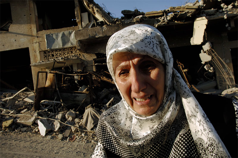 A Lebaese woman weeps as she walks past the destruction in Bint Jbail, one of the villages in South Lebanon most destroyed by the Israeli attacks during the war, Lebanon, August 17, 2006.   Thousands of Lebanese continue to return home to find destroyed homes and the bodies of their loved ones as emergency workers and volunteers unearth the dead and sift through rubble.