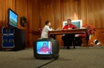 Venezuelan President Hugo Chavez films his weekly radio Presidential address, 'Alo Presidente' , on the 14th day of a nationwide strike in Caracas, Venezuela, December 15, 2002.  Supporters and detracters of President Chavez have been demonstrating simultaneously throughout the city since the beginning of the strike.