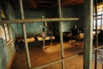 Young men convicted of petty crimes lie around on bug-infested mattresses at the approved school for convicted juveniles in Freetown, Sierra Leone, November 23, 2006.  Unlike the Freetown remand home, the approved school is still undergoing rennovation, and has dire conditions and few resources for food and hygeine.  Most young inmates claim they are fed only one meal a day, there are no toilet or bathing facilities, and only a few old mattresses for sleeping.  Dozens of suspected juveniles are mixed with adult prisoners in prisons throughout Africa, but because of a lack of birth certificates, it is difficult for officials to ascertain who are juveniles, and who are adults.