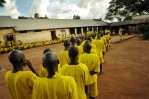 Prisoners who claim to be juveniles line up for dinner in Lira Prison in Lira, Uganda, November 17, 2006.  Dozens of suspected juveniles are mixed with adult prisoners in prisons throughout Africa, but because of a lack of birth certificates, it is difficult for officials to ascertain who are juveniles, and who are adults.