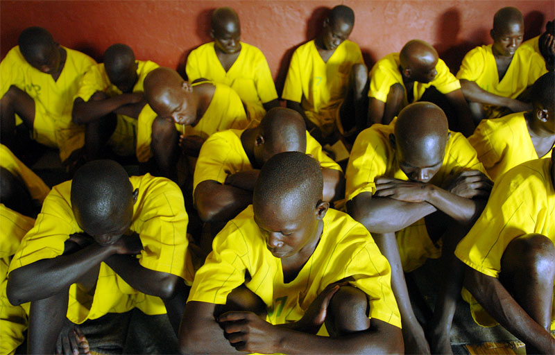 Prisoners who claim to be juveniles hang out in their cell in Lira Prison in Lira, Uganda, November 17, 2006.  Dozens of suspected juveniles are mixed with adult prisoners in prisons throughout Africa, but because of a lack of birth certificates, it is difficult for officials to ascertain who are juveniles, and who are adults.