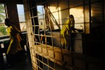 Prisoners clean up after dinner in Lira Prison in Lira, Uganda, November 17, 2006.  Dozens of suspected juveniles are mixed with adult prisoners in prisons throughout Africa, but because of a lack of birth certificates, it is difficult for officials to ascertain who are juveniles, and who are adults.