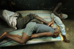 Ugandan kids sleep together in the rehabilitation home for juveniles who have been convicted of petty crimes at the rehabilitation home for juveniles in Kampala, Uganda, November 19, 2006.  Uganda has one remand home for juveniles who have yet to be tried, and one rehabilitation home in Kampala, Uganda.  Across Africa, dozens of suspected juveniles are mixed with adult prisoners in prisons, but because of a lack of birth certificates, and a gross lack of resources for separate facilities, it is difficult for officials to provide separate facilities for children from adults.