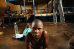 A young woman lies around in the girls' room of the remand home for juveniles who are awaiting trial for crimes in Kampala, Uganda, November 17, 2006.  Uganda has one remand home, and one rehabilitation home, a home for juveniles who have been convicted of crimes, in Kampala.   Across Africa, dozens of suspected juveniles are mixed with adult prisoners in prisons, but because of a lack of birth certificates, and a gross lack of resources for separate facilities, it is difficult for officials to provide separate facilities for children from adults.