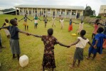 Ugandan street kids play with kids in the rehabilitation home for juveniles who have been convicted of petty crimes at the rehabilitation home for juveniles in Kampala, Uganda, November 19, 2006.  Uganda has one remand home for juveniles who have yet to be tried, and one rehabilitation home in Kampala, Uganda.  Across Africa, dozens of suspected juveniles are mixed with adult prisoners in prisons, but because of a lack of birth certificates, and a gross lack of resources for separate facilities, it is difficult for officials to provide separate facilities for children from adults.