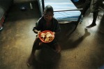 A young boy eats lunch at the remand home for juveniles who are awaiting trial for crimes in Kampala, Uganda, November 17, 2006.  Uganda has one remand home, and one rehabilitation home, a home for juveniles who have been convicted of crimes, in Kampala.   Across Africa, dozens of suspected juveniles are mixed with adult prisoners in prisons, but because of a lack of birth certificates, and a gross lack of resources for separate facilities, it is difficult for officials to provide separate facilities for children from adults.