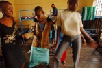 Young women dance around in the girls' room of the remand home for juveniles who are awaiting trial for crimes in Kampala, Uganda, November 17, 2006.  Uganda has one remand home, and one rehabilitation home, a home for juveniles who have been convicted of crimes, in Kampala.   Across Africa, dozens of suspected juveniles are mixed with adult prisoners in prisons, but because of a lack of birth certificates, and a gross lack of resources for separate facilities, it is difficult for officials to provide separate facilities for children from adults.