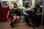 Alaysia rides the subway from the projects in Harlem down to the West Village to join other transgender prostitutes on the stroll in the meat-packing district in New York, May 22, 1999.