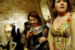 Syrian and international guests attend the opening of the Villa Moda couture store in the old souk in Damascus.  The store, opened by Kuwaiti Sheikh Majed, is the first couture store with imported goods in Syria since the Syrian government lifted the ban on imported goods. March 2006