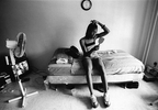 Tiara adjusts her weaves as she hangs out in her bedroom in the projects in Chinatown, New York.  August 1999.