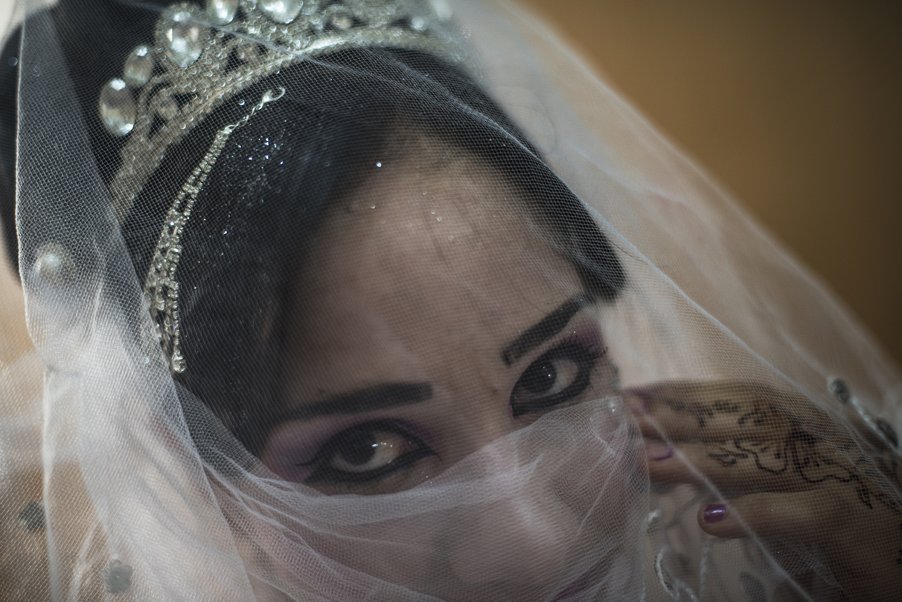 Noor, age unknown (roughly 16), prepares for her wedding later that day in a beauty salon in the Zaatari refugee camp in Jordan, August 25, 2014. While marriage under the age of eighteen was a common Syrian tradition before the start of the civil war, more and more Syrian girls are marrying at a younger age because of the insecurity of the war,  because many families feel the girls in their family may be sexually harassed if they are not under the care of a husband, and because of prospect of alleviating the financial burden of one more mouth to feed.