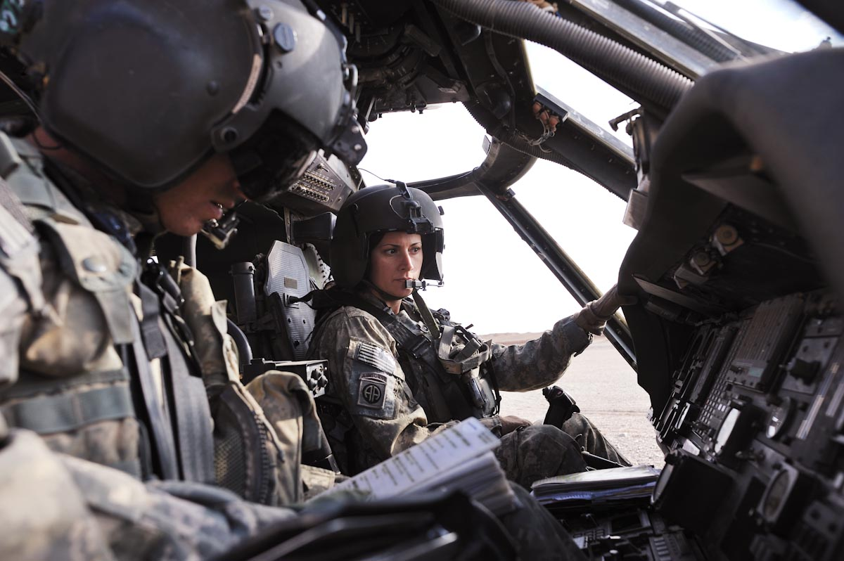 Blackhawk Pilot, CW2 Jessie Russell, with the United States Army MEDEVAC unit with the 82nd Airborne, Charlie Company, out of Fort Bragg, North Carolina, prepares to fly in Helmand Province of Afghanistan, December 1, 2009.