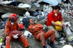 Rescue workers take break from gruelling work at the Ground Zero.