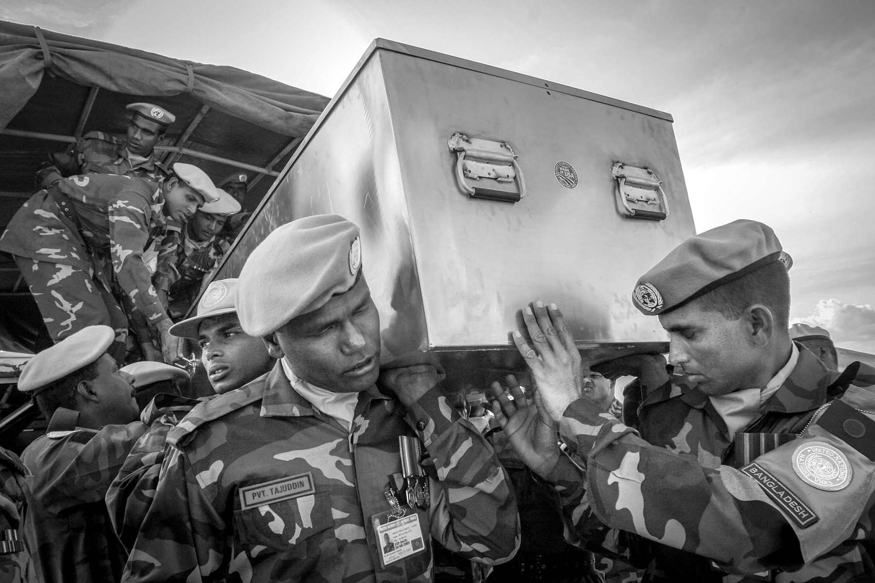 A body of Bangladeshi solder killed in the ambushed by militia groups is being carried out of a truck to a Muslim funeral in Bunia.