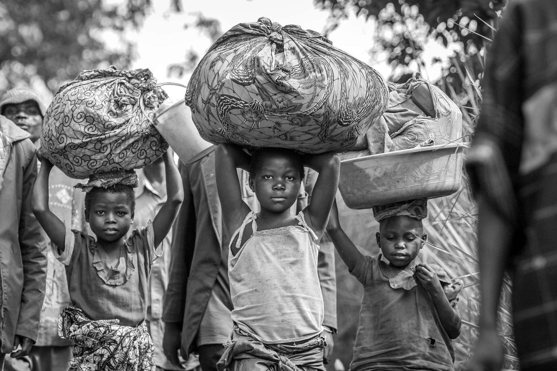 With all they can carry, internally displaced Congolese make a long journey to find a safe haven near the village of Gety.