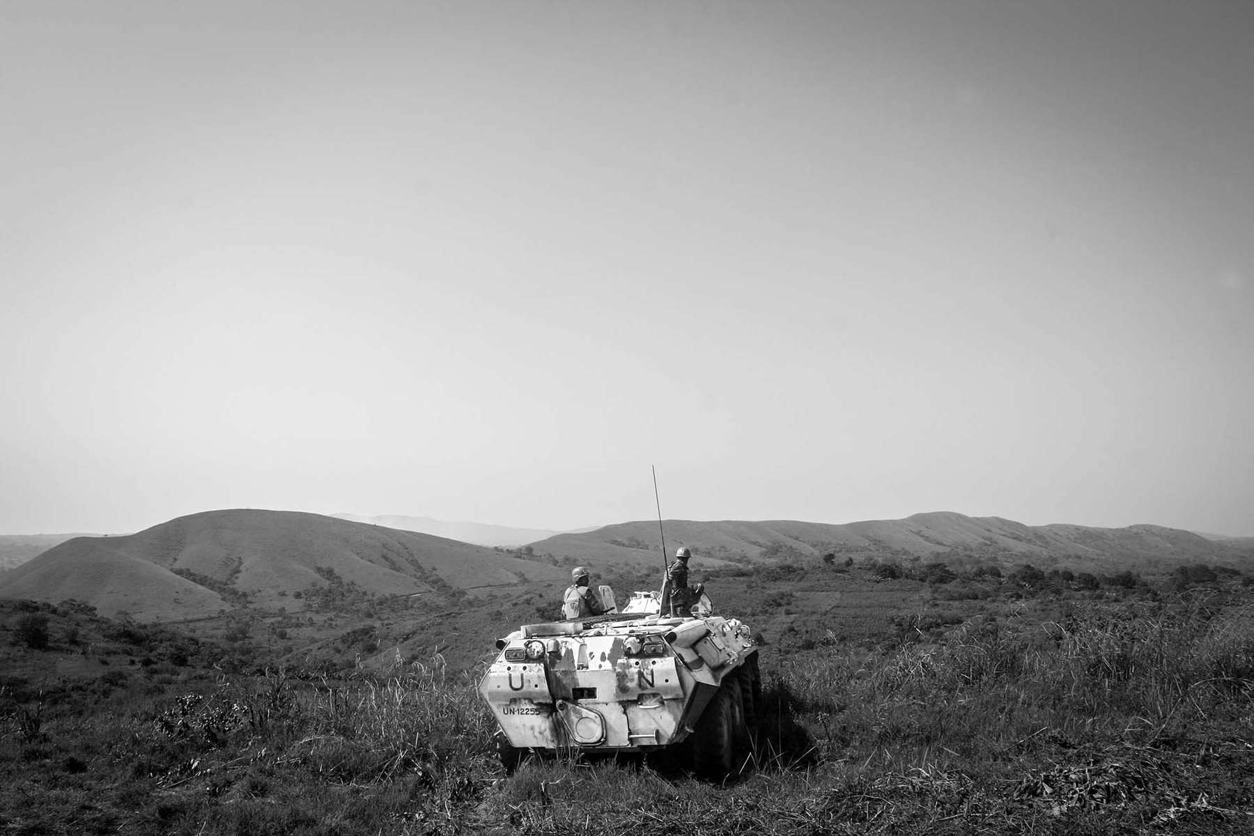 UN peacekeepers from Bangladesh ride their armored personal carrier to the hilltop, over-looking the village of Bavi where there was recent fighting between militia and government solders supported by UN.